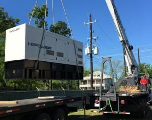 Hipower generator being taken from truck via crane