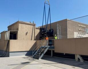 Standby generator installed via crane onto premises